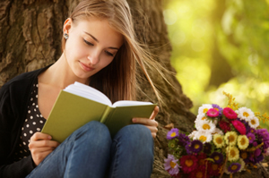 teenage-girl-reading-in-the-forest