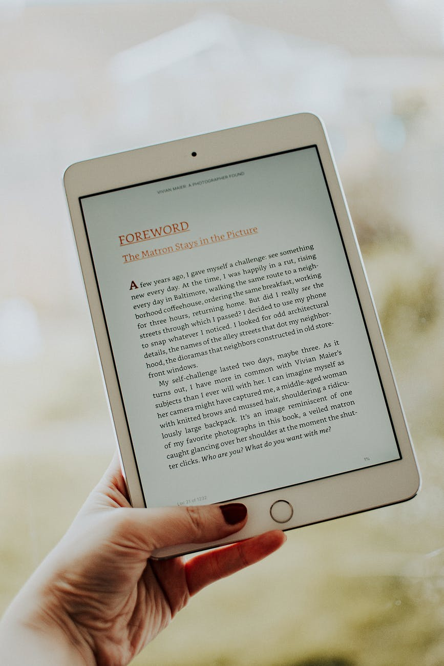 photo of person s hand holding ipad
